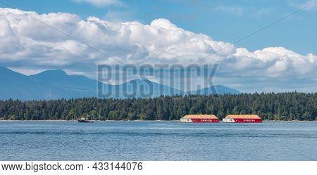 Salt Spring Island, British Columbia, Canada - August 23, 2021: Industrial Tugboat Pulling Seaspan C