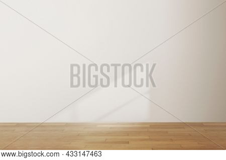 Empty minimal room with natural light on white wall