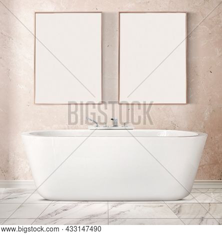 Blank picture frames hanging over a bathtub in luxury bathroom interior design
