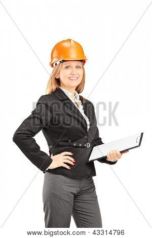 Female engineer with a helmet holding a clipboard and posing isolated on white background