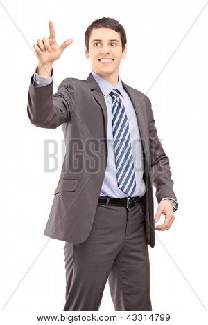 Young businessman in suit touching something imaginery isolated on white background