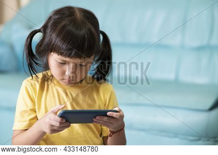 Tired Eyes And Fatigue From Using The Phone For A Long Time, Child Playing Online Games. Internet Or