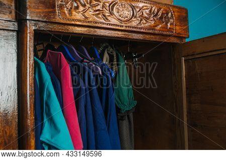 Second Hand Wardrobe, Vintage Clothes On Hangers In The Closet. Circular Economy, Eco Friendly Susta