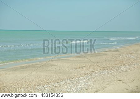 Blue Sea And Sky With Beach . Mediterranean Beach With Turquoise Water In Sunny Weather . Crystal Cl