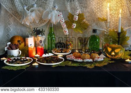 Festive Home Buffet Table With Sweet Snacks And Themed Decorations For Halloween. Halloween Themed F