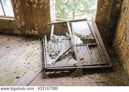 Old Ruined Tumbled Out Window Inside Of Abandoned Building
