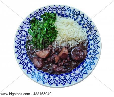Traditional Brazilian feijoada with cabbage and rice