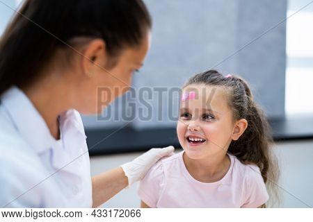 Applying Band Aid To Children Wound. Kid Bandage