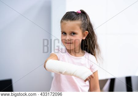 Young Child Girl With Arm Fracture And Cast