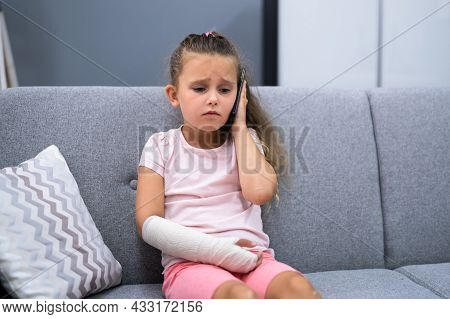 Arm Fracture And Cast. Injured Young Child Recovery Pain