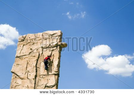 Young Woman Climb Wall
