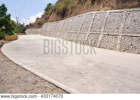 An Example Of Concrete Retaining Wall To Prevent Landslides On Roads. A Retaining Wall With Textured