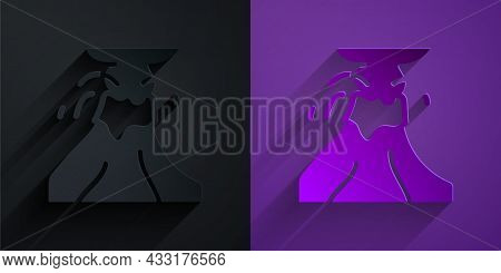 Paper Cut Volcano Eruption With Lava Icon Isolated On Black On Purple Background. Paper Art Style. V