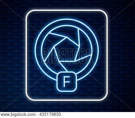 Glowing Neon Line Camera Shutter Icon Isolated On Brick Wall Background. Vector