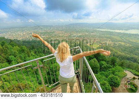 Woman By Zurich Panorama On A Swiss Lookout Tower On Uetliberg Mountain In The Swiss Plateau, In Swi