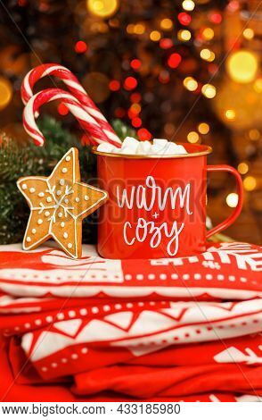 Christmas Cappuccino In Red Mug On Red Blanket With Other Christmas Decorations. Hot Coffee Or Cocoa