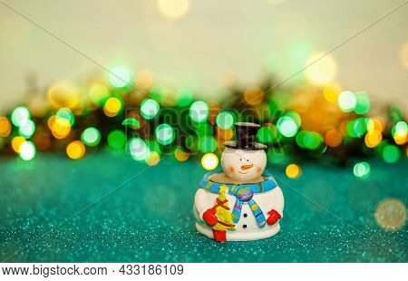 Beautiful Winter Background With Snowman. Winter, New Year, Xmas Concept. Snowman On Abstract Backgr