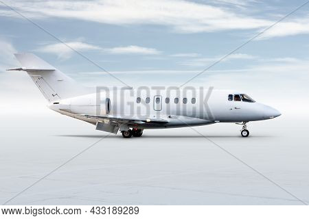 Modern White Corporate Business Jet Isolated On Bright Background With Sky