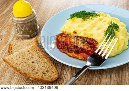 Pepper Shaker, Slices Of Bread, Canned Sprats In Tomato Sauce With Mashed Potato And Dill In Blue Gl