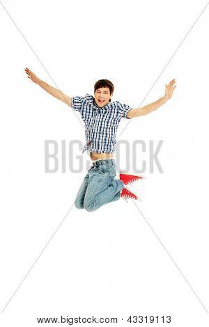 Young happy caucasian man jumping in the air , isolated on white background