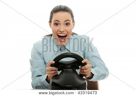 Young caucasian business woman playing on computer (with steering wheel), isolated on white background