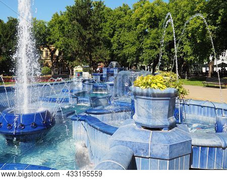 Subotica, Serbia September 12, 2021. Blue Fountain In The Square Next To The Town Hall. Blue Ceramic