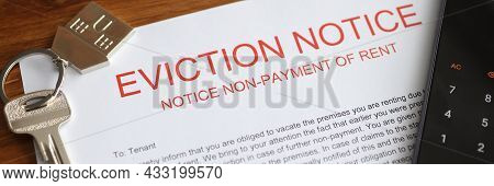 Metal House Keys And Mobile Phone Lying On Eviction Notice Closeup