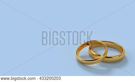 Two Wedding Gold Rings Lie On Each Other With Blank Space Background For Text. Format 16x9. 3d Rende