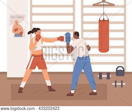 Woman Boxing With Trainer In Gym. Box Coach With Handheld Pad And Boxer Punching In It With Fist In