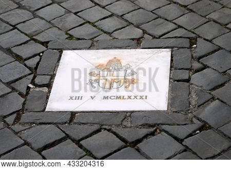 Plaque Made By Pope Benedict Xvi On The Site Of The Attack Which Bears The Coat Of Arms Of John Paul