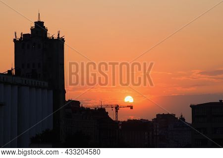 Amazing Sunset Cityscape In Kyiv. Black Silhouette Of The Buildings Against Vibrant Sky With Bright