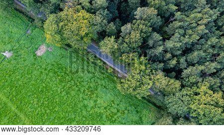 Aerial View Of A Rural Landscape During Sunrise In Belgium. Rural Farm, Corn Fields, Green Fields, S