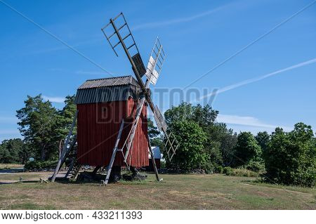 Windmill In The Countryside Of Swedish Baltic Sea Island