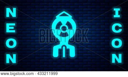 Glowing Neon Nuclear Bomb Icon Isolated On Brick Wall Background. Rocket Bomb Flies Down. Vector