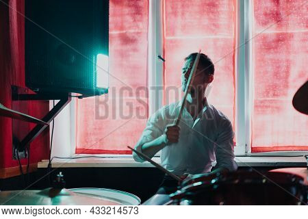 Male Musician With Drumsticks Playing Drums And Cymbals At Concert Or Studio. Music, People, Musical