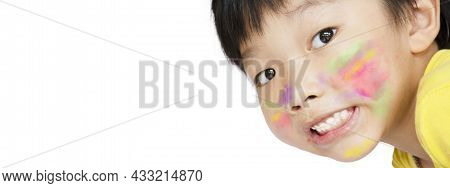 The Asian Little Boy Smiled And Had A Smear Of Watercolor Paint On His Face On White Background With