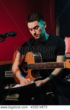 Songwriter Thinking And Writing Notes, Lyrics On Sheets At Studio. Concept For Musician Creative, Ar