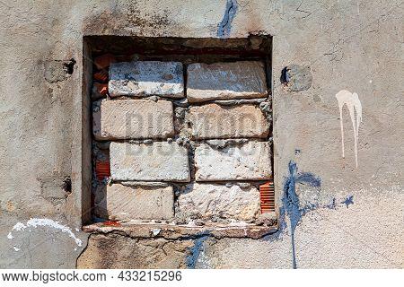 Window Tightly Closed With Bricks . No Light Through The Window . Brick Masonry