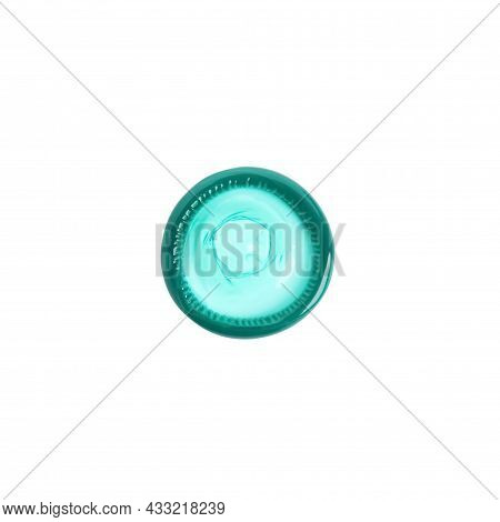 Unpacked Green Condom Isolated On White, Top View. Safe Sex