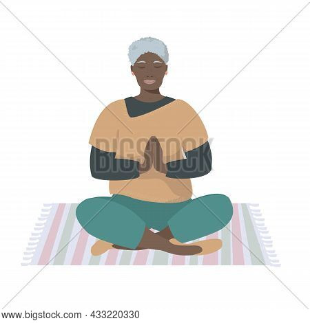 Elderly African-american Woman Is Sitting In Lotus Position, Meditating. The Concept Of Concentratio