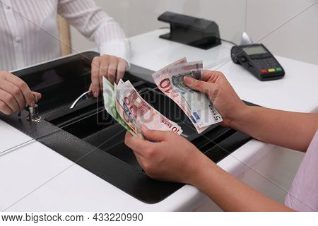 Woman With Money At Cash Department Window, Closeup. Currency Exchange