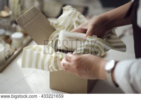 Small Business Owner, Online Marketing Packaging Box And Delivery. A Parcel Wrapped In Brown Paper.