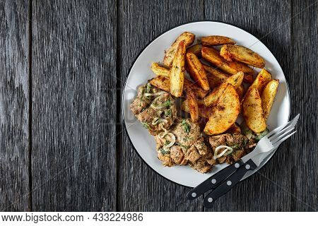 Grilled Pork Shoulder Steaks With Roasted Potato Wedges Seasoning With Paprika And Dill On A Plate W