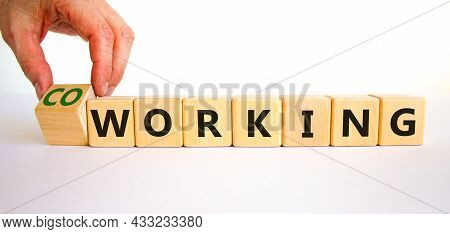 Working Or Coworking Symbol. Businessman Turns A Cube And Changes The Word 'working' To 'coworking'.