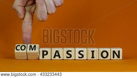 Passion Or Compassion Symbol. Businessman Turns Cubes, Changes The Word Compassion To Passion. Beaut