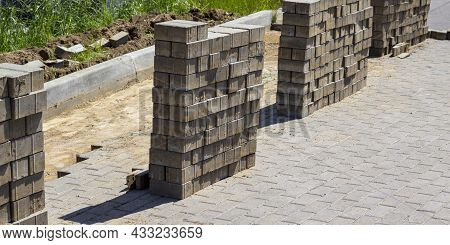 Pile Of Concrete Cement Cinder Blocks At The Construction Site. Sidewalk Construction And Reconstruc