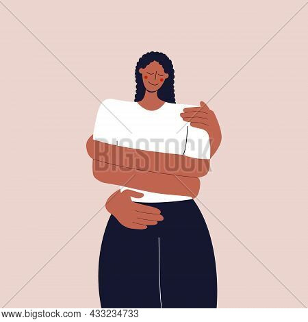 The Concept Of Love And Careful Attitude To Yourself. The Black Girl Hugs Herself By The Shoulders.