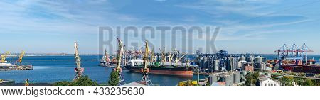 Port Panorama, Ship Loading, Harbor Cranes And Granaries In The Cargo Seaport.