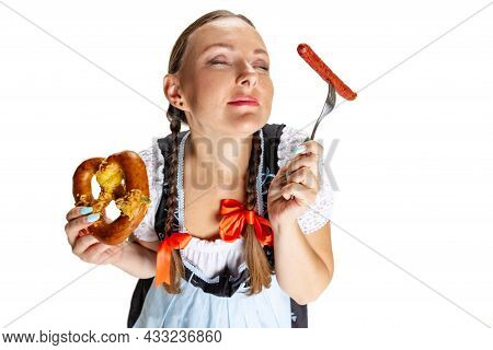 Close-up Happy Oktoberfest Woman, Waitress Wearing A Traditional Bavarian Or German Dirndl Isolated