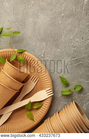 Eco Friendly Disposable Dishes With Green Leaves On Grey Background. Zero Waste, Eco Friendly, Plast